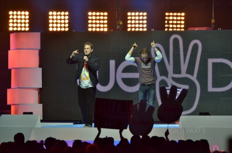 Marc and Craig Kielburger on stage.